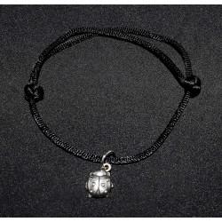 Bracelet en noeuds chinois  boules simples et breloque coccinelle